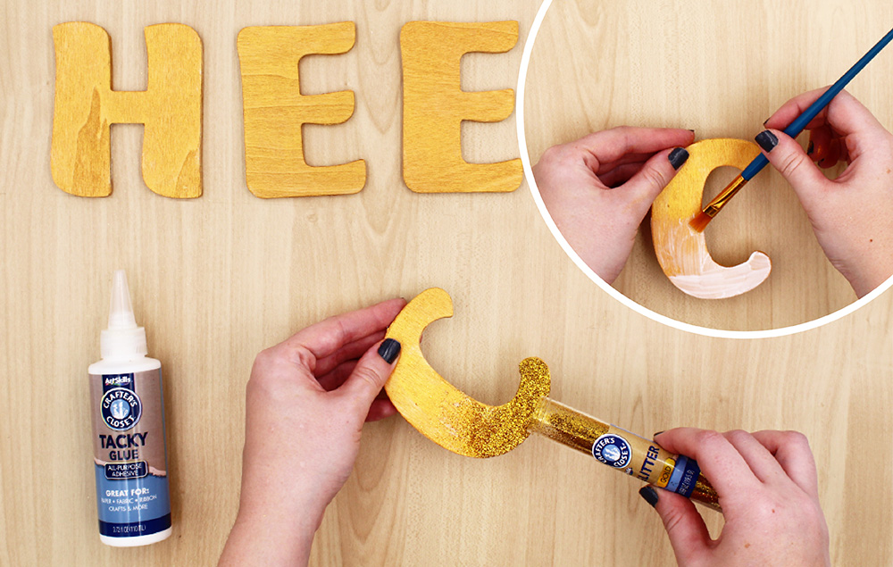 Apply Tacky Glue to bottom of wood letters.