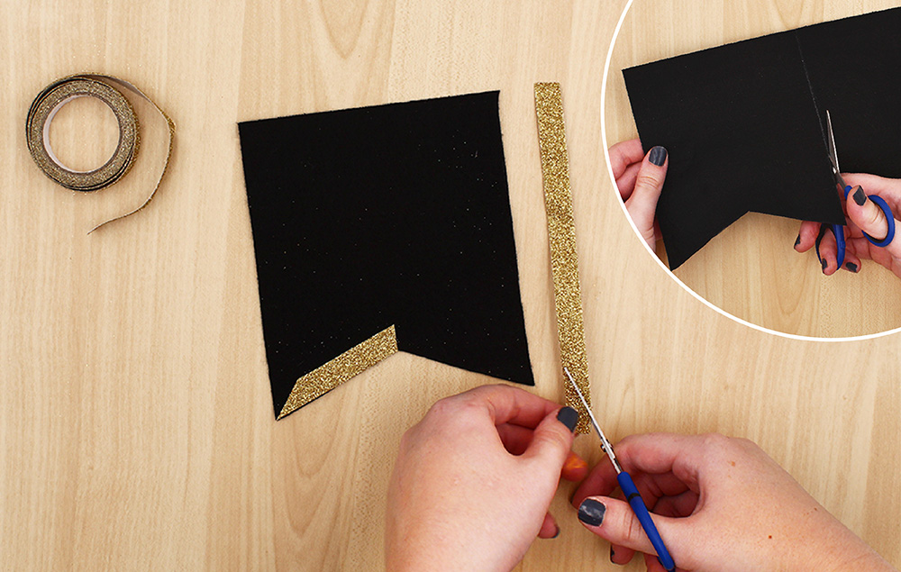 Print and trace flag template on black felt and cut out six flags. Embellish edges of the flags with glitter tape.
